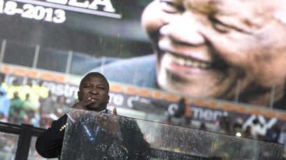A sign language interpreter during the memorial service at FNB Stadium December 10, 2013 in Johannesburg, South Africa. (AFP Photo / Brendan Smialowski)