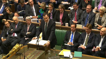 British Chancellor of the Exchequer George Osborne (C) delivering his Autumn Statement on the economy to parliament as British Prime Minister David Cameron (3R) sits on the front bench behind in the House of Commons in central London on December 5, 2013. (AFP Photo /PRU)