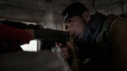 A sniper of the Free Syrian Army (AFP Photo / Zac Baillie)
