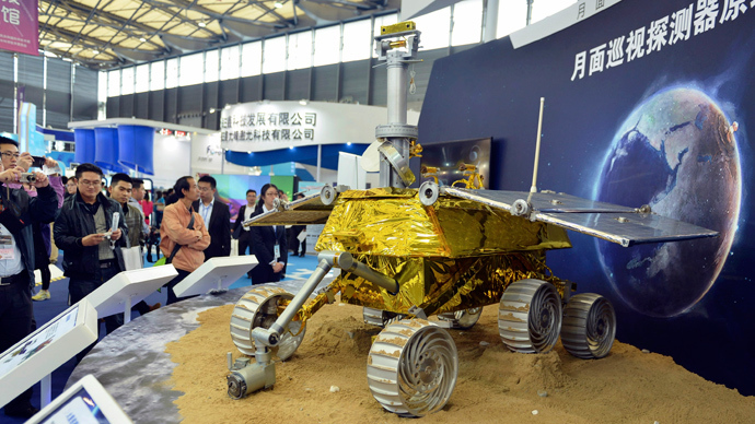 Visitors take pictures of a prototype model of a lunar rover at the 15th China International Industry Fair in Shanghai, November 5, 2013 (Reuters / Stringer)