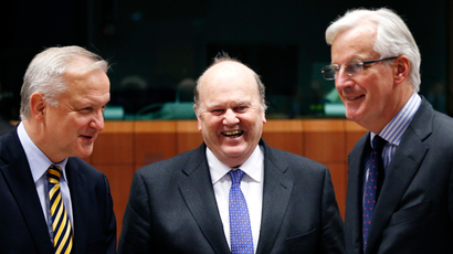 Ireland's Finance Minister Michael Noonan is flanked by European Union Economic and Monetary Affairs Commissioner Olli Rehn (L) and European Commissioner for Internal Market and Services Michel Barnier (R) during a eurozone finance ministers meeting in Brussels  (Reuters / Francois Lenoir)