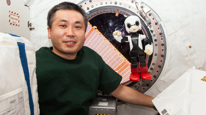 "Japanese astronaut Koichi Wakata (L) smiling with the humanoid robot ""Kirobo"" (R) in the International Space Station (ISS) in space  on December 20, 2013 (AFP Photo / KIBO Robot Project)"
