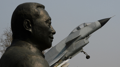 A statue of Wu Daguan who is known as the 'Father of China's military and civilian aviation industry' beside a Chinese produced J-10 fighter jet in Beijing (AFP Photo / Mark Ralston)