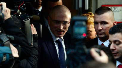 Former Russian oil tycoon and Kremlin critic Mikhail Khodorkovsky leaves after a press conference at the Wall Museum at Checkpoint Charlie on December 22, 2013 in Berlin.( AFP Photo / John Macdougall)