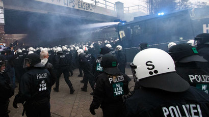 German police use water cannons to clear a street during clashes in front of the 'Rote Flora' cultural centre during a demonstration in Hamburg, December 21, 2013.(Reuters / Morris Mac Matzen)