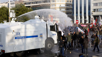 Turkish riot police use water cannons against protesters during a demonstration against Turkey's ruling Ak Party (AKP) and Prime Minister Tayyip Erdogan, in Istanbul December 22, 2013.(Reuters / Osman Orsal)