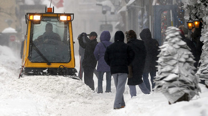 A snow plow cleans the sidewalk during a snowstorm in Quebec City December 22, 2013. (Reuters/Mathieu Belanger)