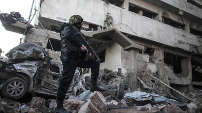 Egyptian security forces inspect the site of a powerful car bomb explosion in the Egyptian city of Mansura, North of Cairo, on December 24, 2013. (AFP Photo/Mahmoud Khaled)