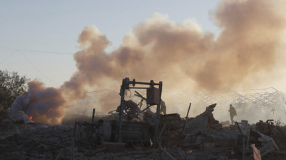 A Palestinian inspects a Hamas training camp after it was hit by an Israeli air strike in Khan Younis in the southern Gaza Strip December 24, 2013. (Reuters/Ibraheem Abu Mustafa)