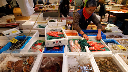 Wholesaler Haruo Shinozaki works at his shop in the Tsukiji fish market in Tokyo.(Reuters / Toru Hana)
