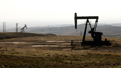 A picture taken on November 25, 2013 shows oil rigs in the Kurdish town of Derik, Syria (AFP Photo)