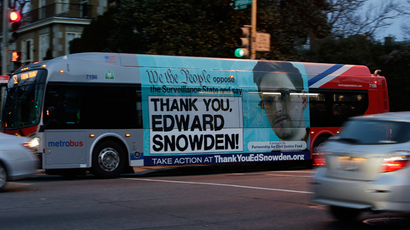 A Washington Metro bus is seen with an Edward Snowden sign on its side panel December 20, 2013 (Reuters / Gary Cameron)