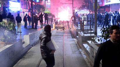 Demonstrators run away as they clash with riot police (unseen) during a protest against corruption in the Kadikoy district of Istanbul on December 25, 2013 (AFP Photo / Bulent Kilic)