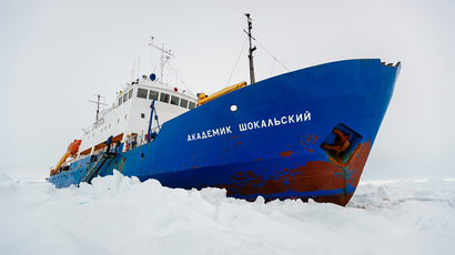 This handout image released by the Centre of Excellence for Climate System Science at the University of New South Wales and taken by Andrew Peacock of www.footloosefotography.com on December 27, 2013 shows the ship MV Akademik Shokalskiy trapped in the ice at sea off Antarctica (AFP Photo / Andrew Peacock)