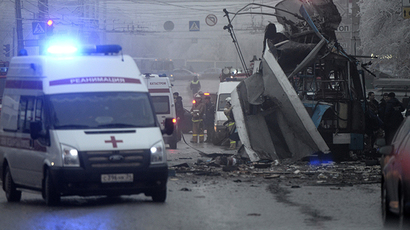 Members of the emergency services work at the site of a bomb blast on a trolleybus in Volgograd December 30, 2013. (Reuters / Sergei Karpov)
