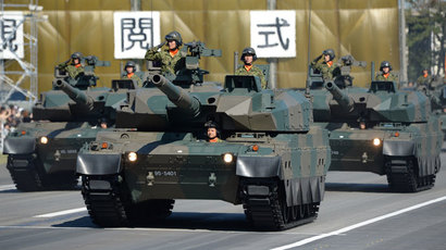 Tank Units parade during the military review at the Ground Self-Defence Force's Asaka training ground on October 27, 2013.(AFP Photo / Toru Yamanaka)