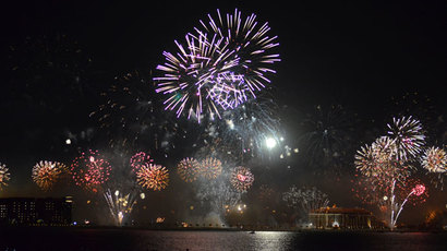 Fireworks explode over Palm Jumeirah in Dubai on January 1, 2014.( AFP Photo / Sahdi Ibrahim)