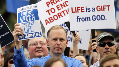Protesters hold signs during an anti-abortion rally at the State Capitol in Austin, Texas, July 8, 2013. (Reuters / Mike Stone)