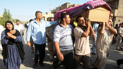 Baghdad : Iraqis carry the coffin of a relative, who was killed the day before in a bomb blast that targeted Shurt al-Raba market, during his funeral in Baghdad (AFP Photo)