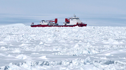 This photo provided by Fairfax Media Pool and released by the Australian Antarctic Division on January 2, 2014 shows the Chinese Antarctic vessel Xue Long (C) from the bridge of the Aurora Australis ship off Antarctica, both in the frozen waters to help rescue a nearby Russian research ship (not pictured). (AFP Photo / Jessica Fitzpatrick)