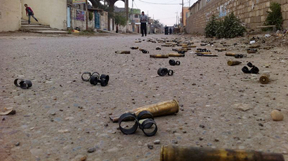 A picture taken on January 3, 2014 shows people in a street with empty bullets on the groud following fighting between Islamist jihadists and Iraqi special forces in the Iraqi city of Ramadi, west of Baghdad. (AFP Photo / Azhar Shallal)