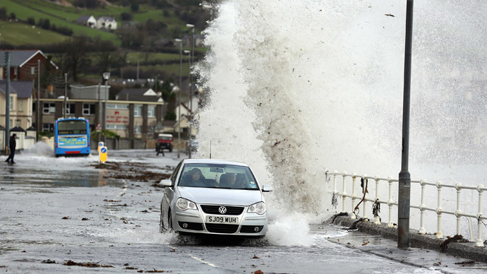 Waves crash against the coastal wall in the village of Carnlough as high tides and strong winds cause some flooding in coastal areas of Northern Ireland January 3, 2014. (Reuters/Cathal McNaughton)