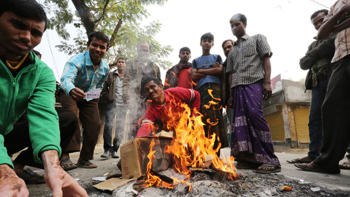 Bangladeshi protestors burn election material at a polling station in the northern town of Bogra on January 5, 2014.(AFP Photo / Stringer)