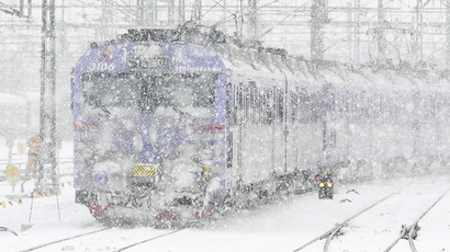 FILE PHOTO. A train goes in heavy snowfall (AFP Photo / Johan Nilsson)
