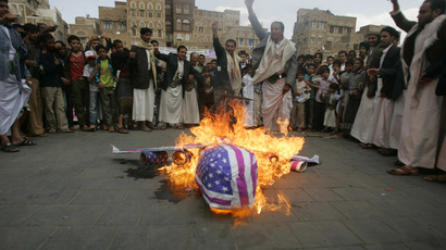 Protesters loyal to the Shi'ite al-Houthi rebel group burn an effigy of a U.S. aircraft during a demonstration to protest against what they say is U.S. interference in Yemen, including drone strikes (Reuters/Khaled Abdullah)