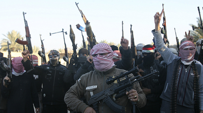 Masked Sunni gunmen chant slogans during a protest against Iraq's Shiite-led government, demanding that the Iraqi army not try to enter the city, in Falluja, 50 km (31 miles) west of Baghdad January 7, 2014. (Reuters)