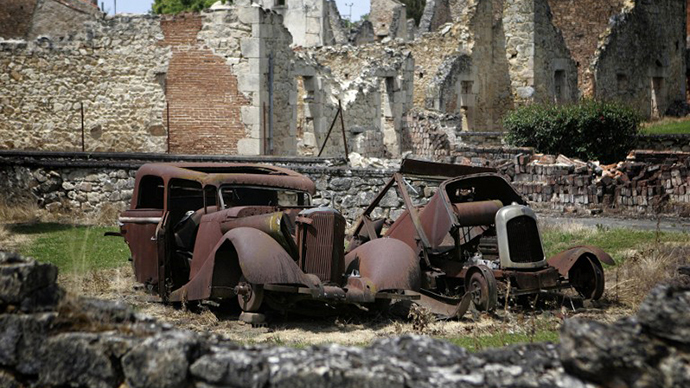 (FILES) A photo taken on June 10, 2006 shows the remains of cars at the partially destroyed village of Oradour-sur-Glane, south-western France, where a German SS Nazi troops massacred 642 people on June 10, 1944. (AFP Photo / Olivier Laban-Mattei)
