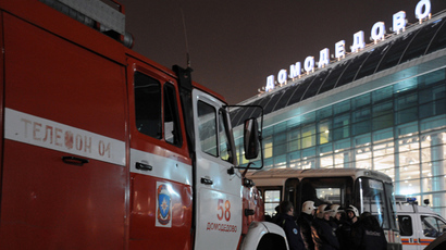 Firefighters and rescuers gather outside Moscow's Domodedovo international airport on January 24, 2011, shortly after an explosion (AFP Photo)