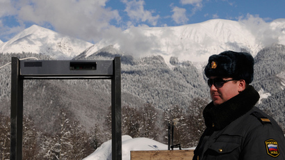 A police officer stands near a metal detector frame at the Gornaya Karusel (Mountain Carousel) sports and holiday complex, that will be used at the 2014 Winter Olympics, in the Black Sea resort of Sochi (AFP Photo)