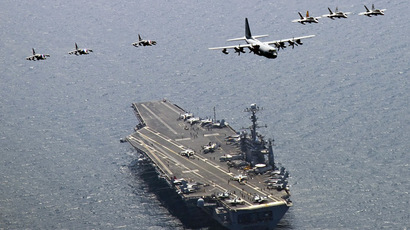 A U.S. Marine Corps C-130 Hercules aircraft leads a formation of F/A-18C Hornet strike fighters and A/V-8B Harrier jets over the aircraft carrier USS George Washington (CVN 73) in the East Sea of Korea (Reuters/Charles Oki/U.S. Navy photo)