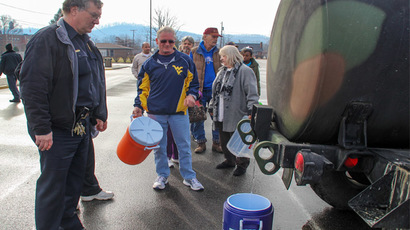 Residents line up for water at a water filling station at West Virginia State University, in Institute, West Virginia, January 10, 2014. (Reuters/Lisa Hechesky)
