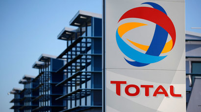 View of the logo of French oil giant Total in front of the oil refinery of Donges, near Nantes.(Reuters / Stephane Mahe)