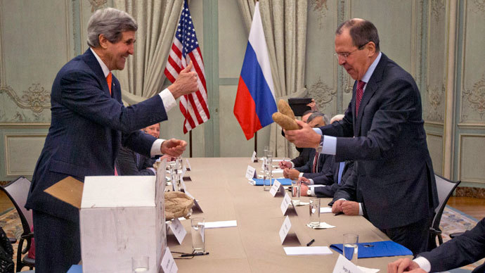 "U.S. Secretary of State John Kerry (L) gives a ""thumbs-up"" sign after giving a pair of Idaho potatoes as a gift for Russia's Foreign Minister Sergei Lavrov at the start of their meeting at the U.S. Ambassador's residence in Paris, January 13, 2014.(Reuters / Pablo Martinez Monsivais)"