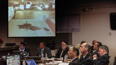Former Fullerton police officers Jay Cicinelli (2nd L) and Manuel Ramos (2nd R) look on as an image of a pool of blood left after Fullerton police arrested Thomas Kelly is shown to the jury during the opening statements by Orange County District Attorney Tony Rackauckas (not shown) in the People v. Ramos and Cicinelli trial at Orange County Superior Court in Santa Ana, California, December 2, 2013. (Reuters / Bruce Chambers)