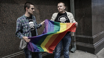 Participants of an unauthorized rally held by gay activists outside the building of the Russian parliament in Moscow.(RIA Novosti / Andrey Stenin)