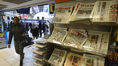 Newspapers are seen on sale at Victoria Station in central London (Reuters / Paul Hackett)
