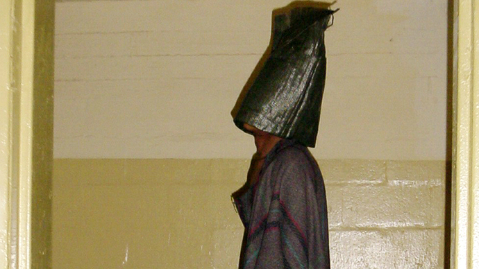 This handout photo from SBS TV received 15 February, 2006 shows a hooded prisoner allegedly being tortured at Iraq's notorious Abu Ghraib jail supposely during interrogation by US soldiers in Baghdad in 2004. (AFP Photo)