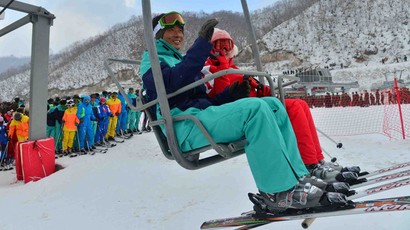 skiers riding on a ski lift during the opening ceremony on December 31, 2013 of the ski resort at Masik Pass in North Korea's Kangwon province (AFP Photo / KCNA via KNS). Video courtesy: YouTube/koryogroup