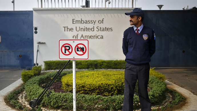 A private security guard stands outside the U.S. embassy in New Delhi (Reuters/Anindito Mukherjee)