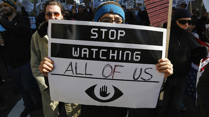 "A demonstarator holds up a sign at the ""Stop Watching Us: A Rally Against Mass Surveillance"" march near the U.S. Capitol in Washington, October 26, 2013.(Reuters/Jonathan Ernst)"