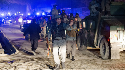 Afghan police arrive at the scene of an explosion in Kabul on January 17, 2014.(AFP Photo / Johannes Eisele)