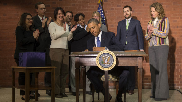Safe from shutdown: Obama signs trillion-dollar budget