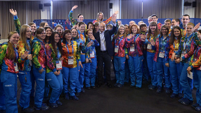President Vladimir Putin, center, meets with the volunteers taking part in preparing and holding the 22nd Winter Olympic Games and 11th Winter Paralympic Games in Sochi. (RIA Novosti/Aleksey Nikolskyi)