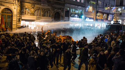 Police use a water cannon to try to disperse people protesting against newly proposed restrictions on the use of the internet and against the Turkish government during a protest on the Istiklal Avenue in Istanbul, on January 18, 2014 (AFP Photo / Mete Carkci)