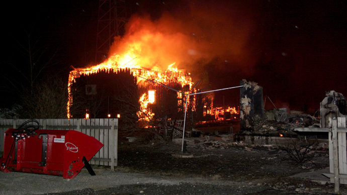A fire blasts over a house, destroying many of the famed 18th- and 19th-century wooden houses in the village Laerdal, southern Norway, on January 19, 2014. (AFP Photo / NTB / Arne Veum Norway out)
