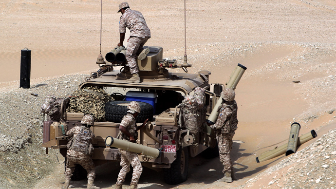 UAE soldiers load their military vehicle with rockets during manoeuvres with the French army in the desert of Abu Dhabi (AFP Photo / Karim Sahib)